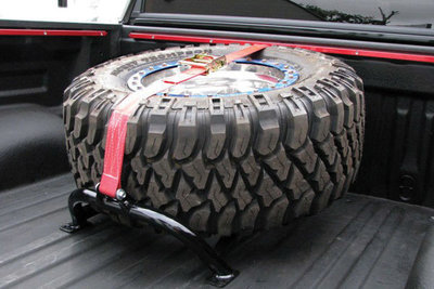 ex_q80_w600_h600_images_feature_nfab-universal-bed-mounted-tire-carrier.jpg
