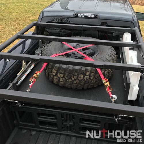 Tire shelf with Hi-Lift and Rotopax Mounts.jpg